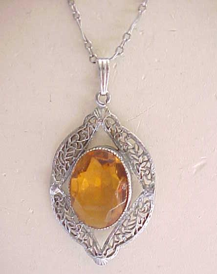Exquisite Filigree Necklace with Amber Rhinestone