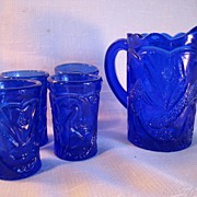 Cobalt Blue Pressed Glass Peacock Bird Design Miniature Pitcher with Four Glasses