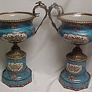 Matched Pair Decorative Porcelain Urns with Metal Mounts