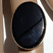 Vintage large black stone gold tone ring