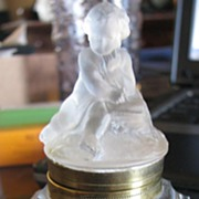 Baccarat inkwell with satin cherub