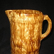 Large sponge ware type water pitcher with raised Peacock motif.