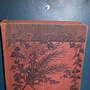 Treasure Island R. L. Stevenson hardback book. No dust cover. Red cover with black vine motif. Gold color lettering. Advance edition.