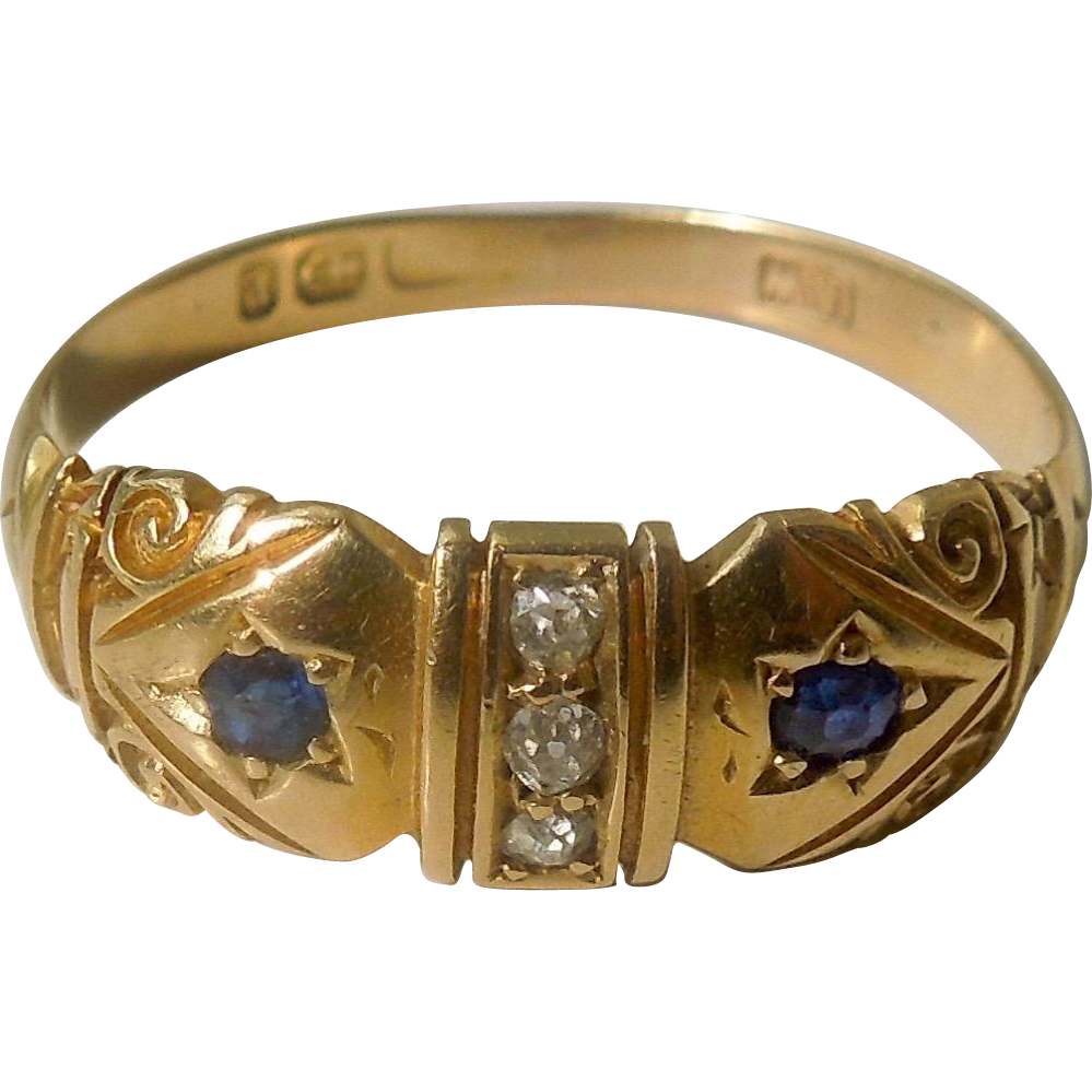 "18 carat ""Gypsy"" band with two sapphires and three rose cut diamonds"