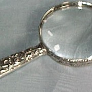 Silver Magnifying Glass with silver rim
