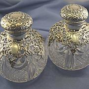 Pair of sterling & crystal English perfume bottles