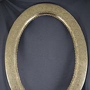 Persian silver hand chased oval frame