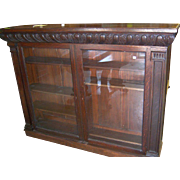 Oak two door bookcase with nice carved detail