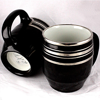 Mid 20th Century Hall China Company Pair of Hefty Glossy Black Ceramic Mugs With Sterling Silver Overlay Decoration
