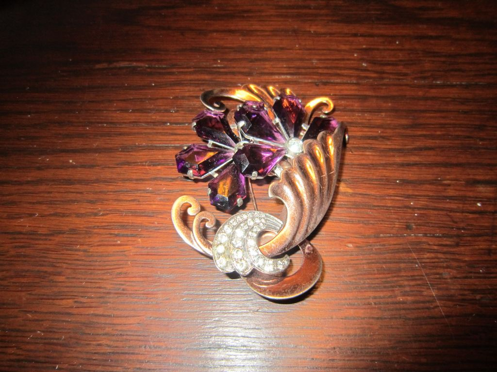 Large Purple Unfoiled Rhinestone,  Swirled Gold Tone Swirls Brooch