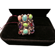 Nakai Sterling Ring with Mixed Turquoises, Garnets, Amethysts and a Pink Stone.