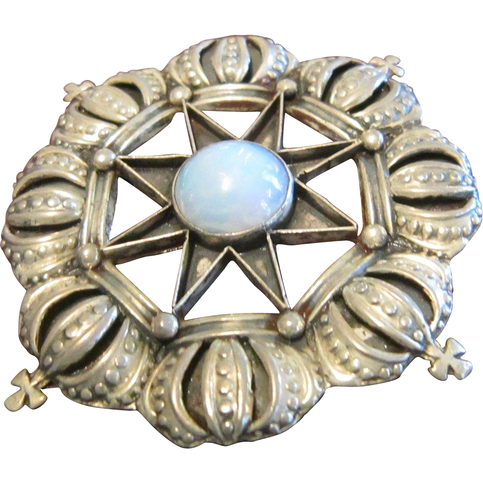 Taxco, Anton Sterling Circle Brooch with Crowns and a Faux Opal