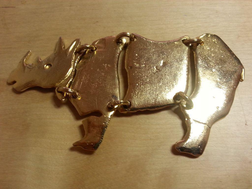 SCHERRER Paris goldtone segmented rhinocerous brooch COUTURE!