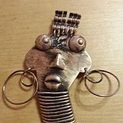 REBAJES Silvertone Ubangi African face Pin