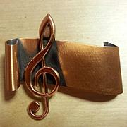 RENOIR copper treble clef brooch