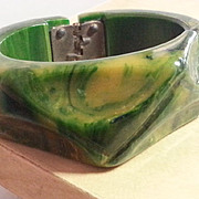 Green end of day marbelized Bakelite hinged bracelet