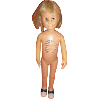 "1962 ""Charmin' Chatty"" Cathy voice box doll.  Original accessory shoes in package."