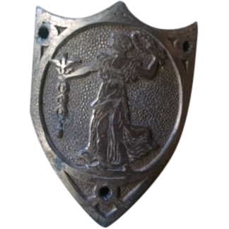Nickel alloy metal shield badge emblem with Lady, peace wreath and caduceus.