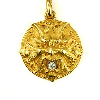 """An Exceptional Gold & Diamond Revivalist """"Cat"""" Pendant, French, mid to late 1800s"""