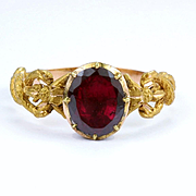 A Symbolic Garnet Caduceus Ring, late 18th to early 19th century