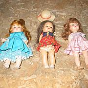 """Three   8"""" Hard Plastic Dolls"""