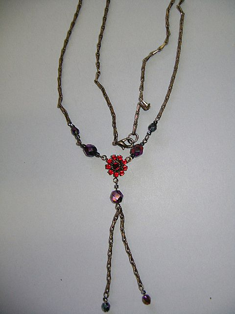 Older Necklace and Earrings Garnet like stones.