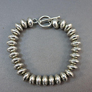 VINTAGE  Sterling Disks on a chain Bracelet  Toggle closure