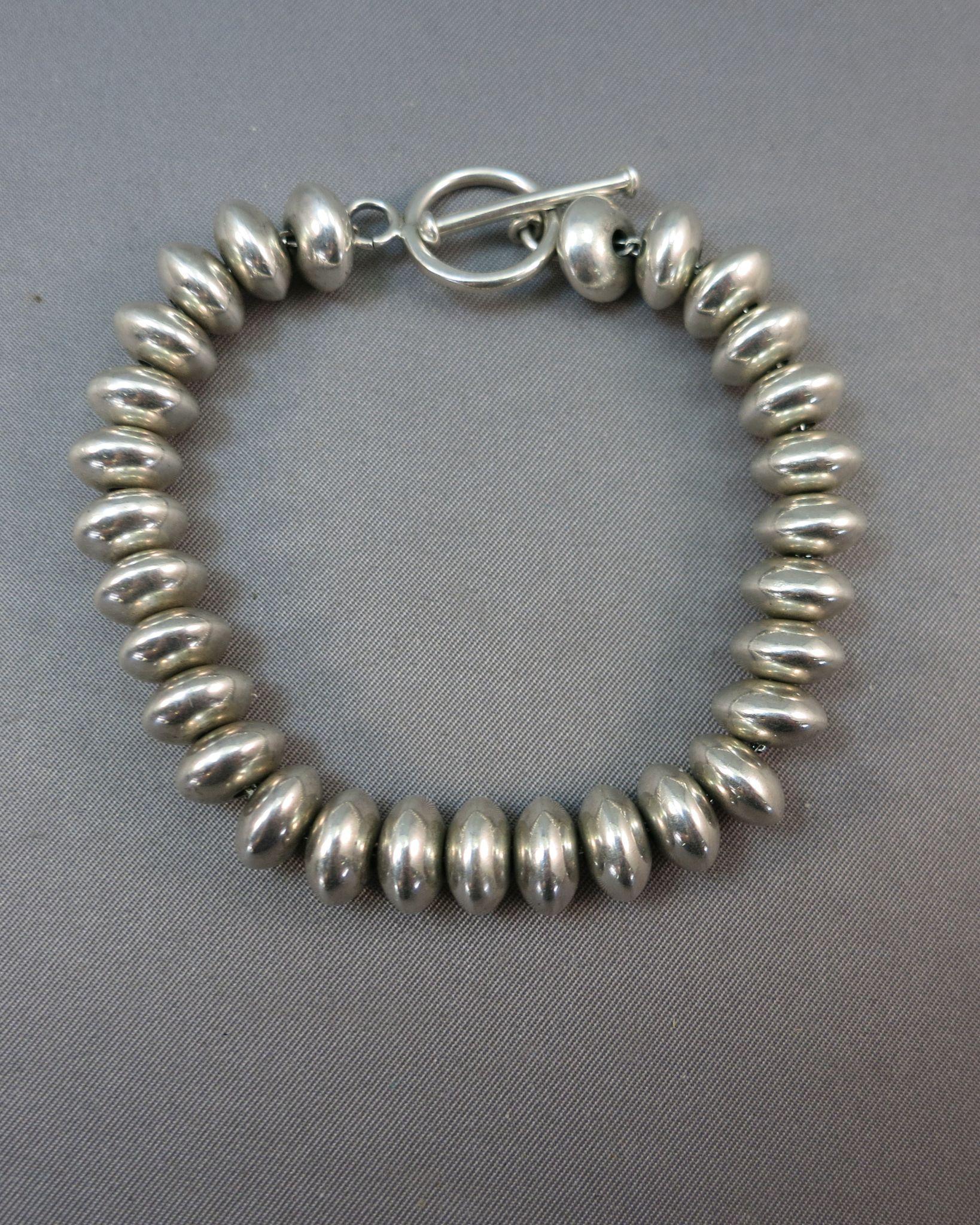 VINTAGE  Sterling Disks on a chain Bracelet  Toggle closure