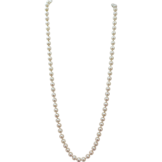 VINTAGE 24 Inch 8-7 mm Fresh-water  Pearls knotted 14K yellow Gold Closure