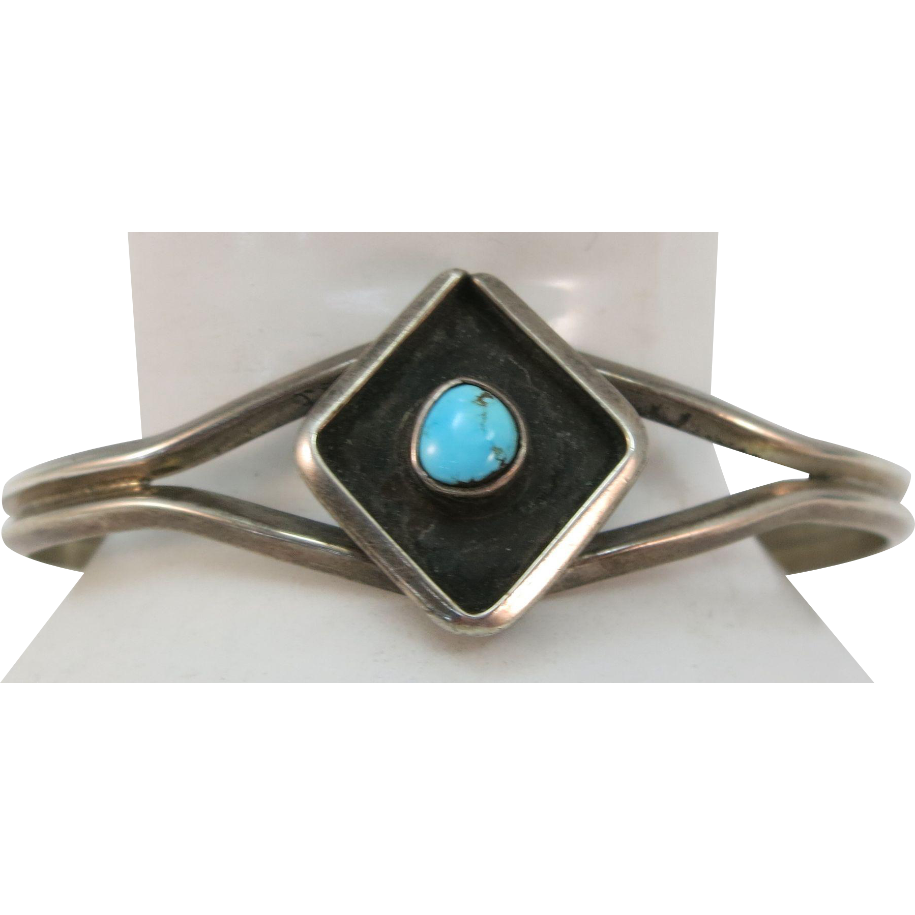VINTAGE  Sandcast Sterling (tested) Bracelet with a small Turquoise set