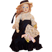 "1950's:  7 3/4""  Virga Gibson Girl Doll ; Hat, Parasol, and Peplum"