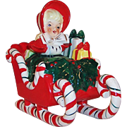 1958 Lefton Christmas Girl Shopper in Candy Cane Sleigh