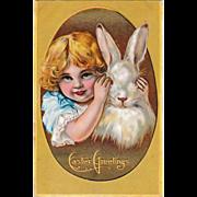 C. 1910 Easter Postcard Peek a Boo Bunny & Girl