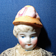 Bisque Bonnet Doll with jointed head arms and legs Germany