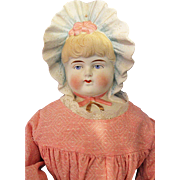 German Bisque Molded Bonnet Doll
