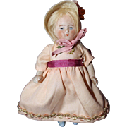 All Bisque Girl Doll in bonnet