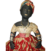 Early Cloth Black Doll seated