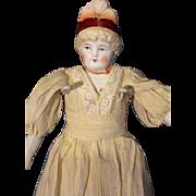 Molded bonnet bisque doll