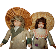 German Celluloid Doll Pair with cloth bodies original clothing