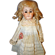 Closed Mouth Bisque Doll with solid dome head