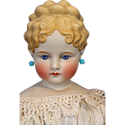 Blond Parian Turned Shoulder head and up swept hairdo