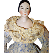 Early China Doll with coiled bun 1840