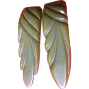 Two matching- carved Bakelite-dress  Clips