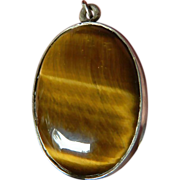 Wonderful large-domed Tigers eye pendant- silver mounting