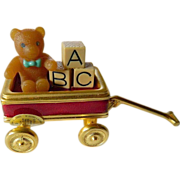 Estee Lauder- solid perfume- with Bear in wagon enameled figure box