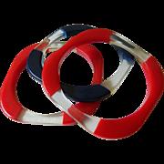 Three lucite bangle Bracelets
