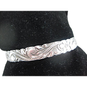 Beautifully Sculpted Silver Bangle - size 8.5 to 9