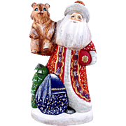 Russian Santa/Father Christmas Holding A Bear Cub
