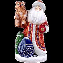 Russian Santa/Father Christmas Holding A Bear Cub