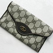 GUCCI Brown Monogram Clutch Wallet